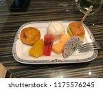 mixed break snacks on plate... | Shutterstock . vector #1175576245