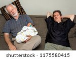 three asleep on a couch.  a... | Shutterstock . vector #1175580415