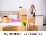 young woman moving to new place | Shutterstock . vector #1175602492