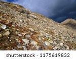 dark storm clouds forming over... | Shutterstock . vector #1175619832