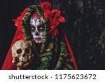calavera catrina holding a... | Shutterstock . vector #1175623672
