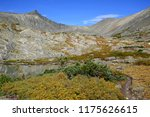 alpine scene while hiking and... | Shutterstock . vector #1175626615