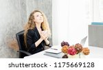 happy young woman working on... | Shutterstock . vector #1175669128