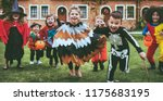 little kids at a halloween party | Shutterstock . vector #1175683195