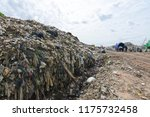 Small photo of Waste from garbage and plastic degraded by natural methods. It requires storage space.