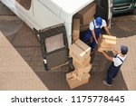 male movers unloading boxes... | Shutterstock . vector #1175778445