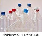 empty plastic drinking bottles... | Shutterstock . vector #1175783458