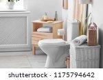toilet bowl in modern bathroom... | Shutterstock . vector #1175794642