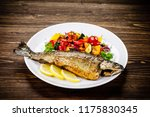 fish dish   roast trout with... | Shutterstock . vector #1175830345
