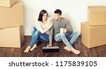 young loving couple moving to a ... | Shutterstock . vector #1175839105