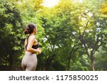 back view of beautiful indian... | Shutterstock . vector #1175850025