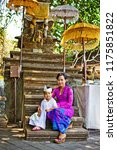 happy balinese mother in temple ... | Shutterstock . vector #1175851822