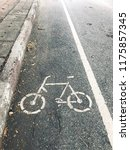 bicycle path symbol on the road. | Shutterstock . vector #1175857345