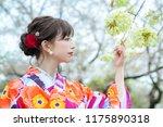 young asian girl wearing kimono ... | Shutterstock . vector #1175890318