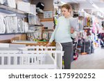 pregnant woman is selecting... | Shutterstock . vector #1175920252