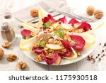 chicory salad with apple and...   Shutterstock . vector #1175930518