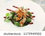 plate with tasty chicken salad... | Shutterstock . vector #1175949502