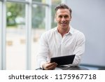 portrait of a businessman... | Shutterstock . vector #1175967718