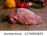 raw pork meat over wooden... | Shutterstock . vector #1176004825