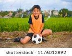 lifestyle portrait of handsome... | Shutterstock . vector #1176012892