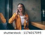 positive female student in... | Shutterstock . vector #1176017095