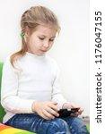 little caucasian girl has... | Shutterstock . vector #1176047155