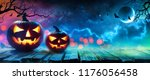 halloween pumpkins glowing in... | Shutterstock . vector #1176056458