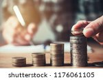 business man putting coin in... | Shutterstock . vector #1176061105