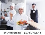 smiling woman chef approving... | Shutterstock . vector #1176076645