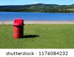 red garbage can at park with... | Shutterstock . vector #1176084232