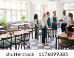 staff attending team meeting in ... | Shutterstock . vector #1176099385