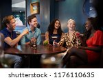 group of young friends sitting... | Shutterstock . vector #1176110635