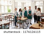 staff attending team meeting in ... | Shutterstock . vector #1176126115