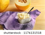 bowl with ripe sliced melon on... | Shutterstock . vector #1176131518