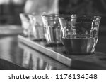 alcoholic beverage on a wooden... | Shutterstock . vector #1176134548