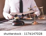 male lawyer or judge working... | Shutterstock . vector #1176147028