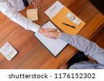 real estate agent and customer... | Shutterstock . vector #1176152302