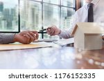 real estate agent and customer... | Shutterstock . vector #1176152335