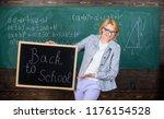 lady educator in classroom... | Shutterstock . vector #1176154528