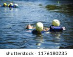 people in water in helmets and... | Shutterstock . vector #1176180235