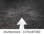 white arrow on asphalt   Shutterstock . vector #1176187282