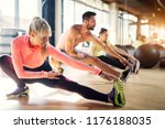 young tired athletes in a gym... | Shutterstock . vector #1176188035