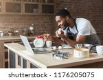 excited black man baking pastry ... | Shutterstock . vector #1176205075