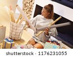 adult woman at home wrapping... | Shutterstock . vector #1176231055