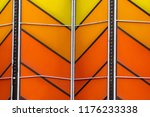 Detailed background of shades of orange and yellow panels. 1970s style colors with a metal texture