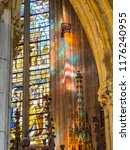 Small photo of LIEGE, BELGIUM - NOVEMBER 01, 2015: Beautiful interior detail from St. Paul's Cathedral with stained glass window and sunlight reflections