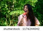 lady attractive brunette eats... | Shutterstock . vector #1176244042