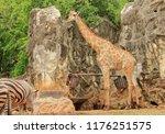 a beautiful image of a giraffe  ... | Shutterstock . vector #1176251575