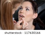 make up artist applying lip... | Shutterstock . vector #117630166