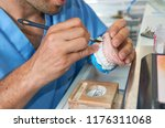 dental technician using a brush ... | Shutterstock . vector #1176311068